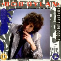 This was an odd time for Bob Dylan; he became a fervent born-again Christian (despite being raised Jewish), and then sort of forgot all about that. That may look like an eighties perm, but Dylan's hair has been that way forever. He always was a trailblazer. Speaking of blazers: that's a doozy he's sporting there.